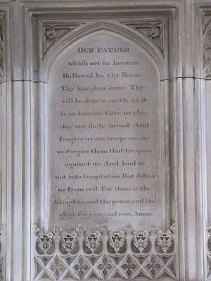 English: Lord's Prayer A tablet behind the alt...