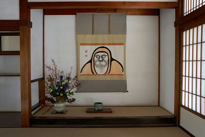 A Japanese tokonoma with a hanging scroll and Ikebana