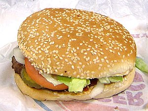 A Burger King hamburger sesame seed bun, as se...