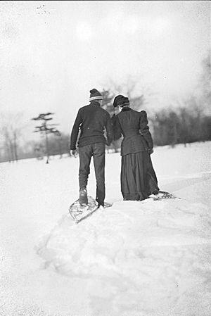 Couple snowshoeing, Toronto, Canada
