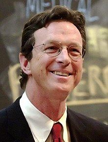 Michael Crichton wearing a suit.