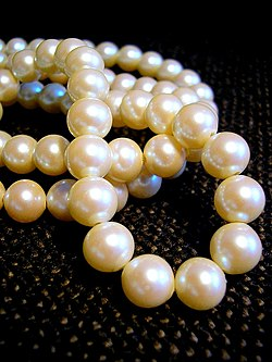 White pearls strung on a necklace