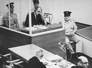 English: The Defendant inside his glas booth d...
