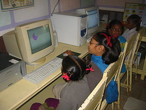 English: Girls getting computer class near Bar...