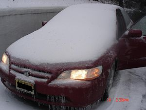 English: New Jersey car covered in snow and ic...