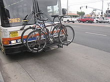 Front-mounted bike rack on public transit bus in USA - pic by Buchanan-Hermit, Wikimedia Commons, CC-BY-2.0