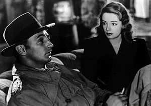 Robert Mitchum as Jeff Bailey and Jane Greer a...