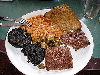 Square sausage (lower right) served with black...