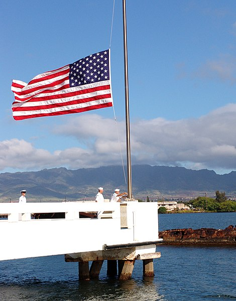 Flag flies at half-staff over the USS Utah, in Pearl Harbor (2004 photo – Pearl Harbor, Hawaii (May 31, 2004) – Sailors assigned to ships based at Pearl Harbor bring the flag to half-mast over the USS Utah Memorial on Ford Island in honor of Memorial Day May 31, 2004. U.S. Navy photo)