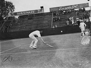 English: Tennis player in action in Brisbane, ...