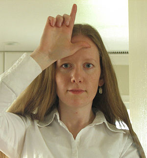 Woman doing the loser sign