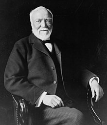 Andrew Carnegie, three-quarter length portrait, seated, facing slightly left, 1913.jpg