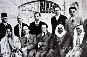 Moshe Shertok (Sharett) (standing, right) at a...