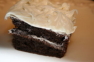 English: Chocolate cake with white icing.