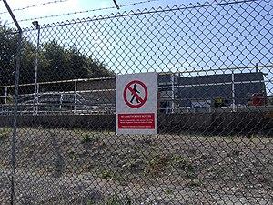 English: Security fence and sewage works, Harw...