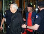 English: Father Daniel Berrigan is arrested fo...