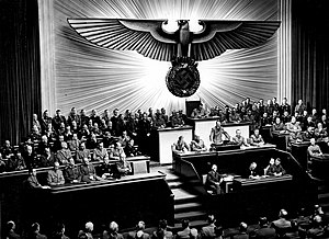 Adolf Hitler addressing the Reichstag with his...