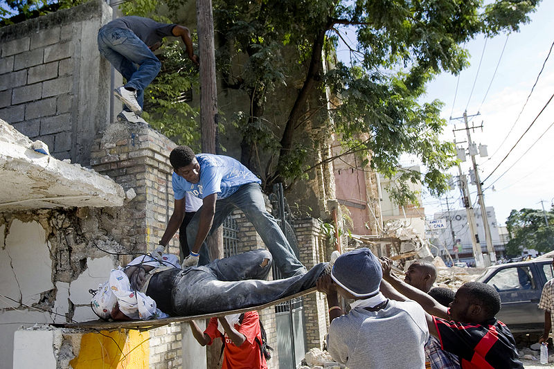 Haitians pull out a victim from the rubble of a school in Port au Prince, Haiti. The 7.0 earthquake killed thousands and has permanently displaced millions.