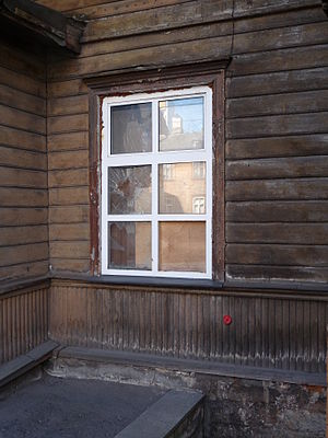 English: Broken glass in window