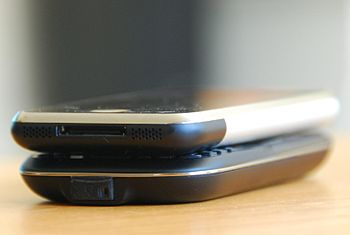 An Apple iPhone in comparison to a HTC S620
