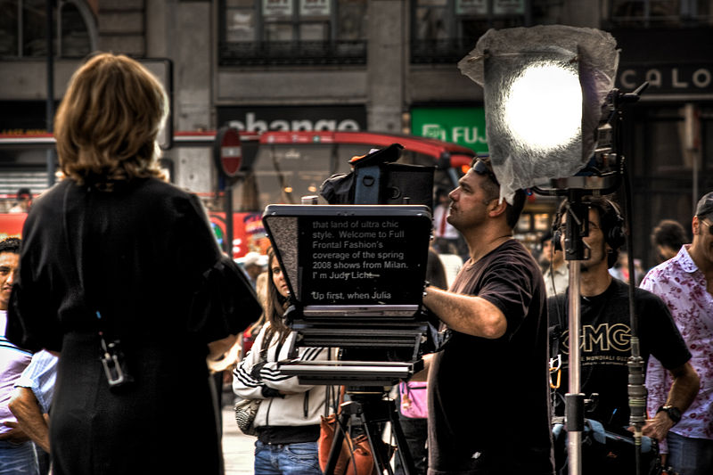 Judy Licht using a teleprompter in a broadcast from Italy.