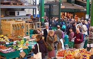 English: Crowds shopping at Borough market, so...