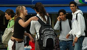 Young people interacting within society.