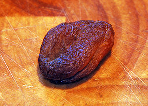 Whole pitted dried organic apricot (Prunus arm...