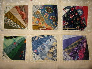 A mini quilt made by sewing through a pattern ...