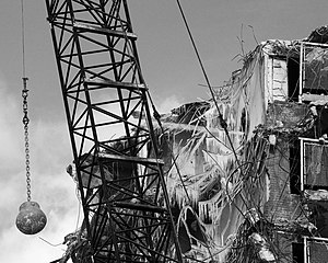 Wrecking ball in use during demolition of the ...