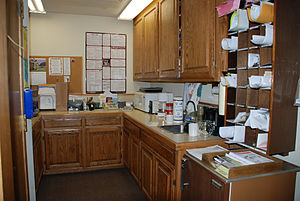 English: A typical mailroom and kitchenette
