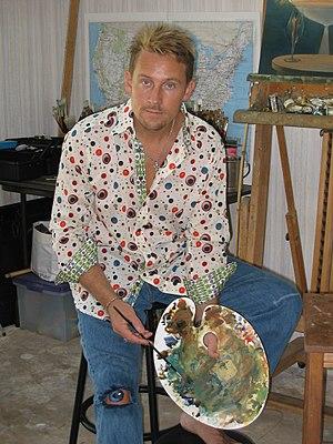 Vladimir Kush, the artist, painting one of his...
