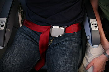 Seat belt on an airplane, buckled-up