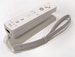 An image of the Wii remote (with wrist strap) ...