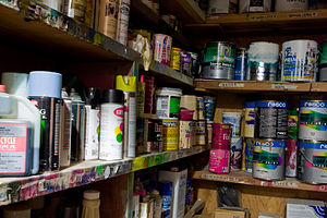 A collection of cans of paint and other relate...