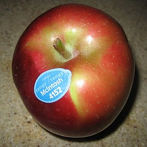 McIntosh apple with sticker. Cropped from the ...