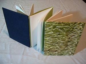 Hand decorated paste paper (right hand side); ...