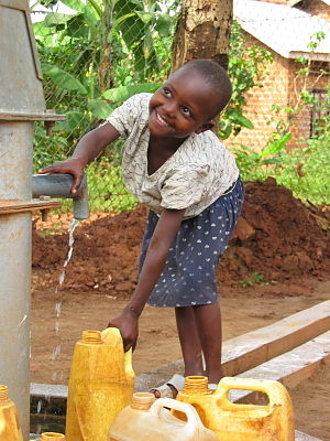 Ugandan girl at a well funded by Blood:Water M...