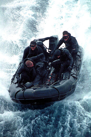 Members of the Sea Air Land Team Five (SEAL5),...