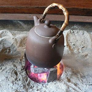 Korean tea kettle over hot coal