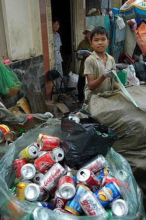 A smiling boy recycling garbage in Saigon.
