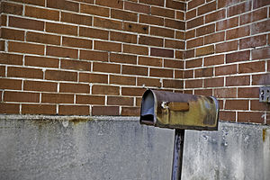 Mailbox with brick background