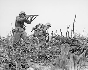 Okinawa, 1945. A U.S. Marine aims a Thompson s...