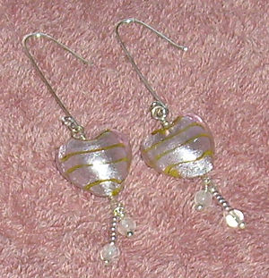Handmade earrings in sterling silver, glass, a...