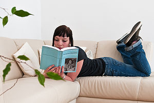 Girl Reading a Wikpedia-Book from PediaPress