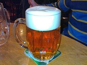 A pilsner urquell glass