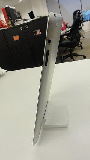 English: Side view of an iPad 2 in an iPad dock.
