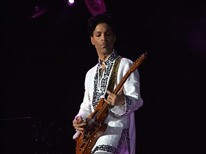 English: Prince playing at Coachella 2008.
