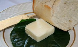 English: A pat of butter, served on a leaf, wi...