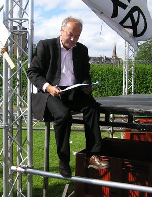 Galloway signing an asylum seekers petition, s...